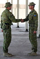 Commander Task Group Taji 2 Colonel Gavin Keating, CSC (right) hands over command of the Task Group to Commander Task Group Taji 3 Colonel Andrew Lowe at a Transfer of Authority parade at the Taji Military Complex in Iraq.