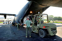 A RAAF C-130 Hercules is prepared for departure from Dili Airport as part of the remediation of personnel and equipment at the conclusion of the Australian Defence Force's security mission in Timor-Leste