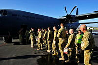 Personnel from ANZAC Company board a RAAF C-130 Hercules to return home after a three month deployment at the conclusion of the Australian Defence Force's security mission in Timor-Leste.