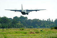 A RAAF C-130 Hercules is airborne on the journey from Dili to Richmond Air Base as part of the remediation of personnel and equipment at the conclusion of the Australian Defence Force's security mission in Timor-Leste