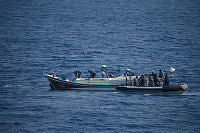 HMAS Darwin's boarding party board a suspicious Shi'ai Dhow to conduct a search for illegal contraband.