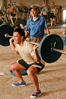 Sergeant Debbie Grylls, a Royal Australian Air Force Physical Training Instructor (PTI), coaches Corporal Nicolas Sheriff from Multi National Base Command – Tarin Kot in Orion's Gym.