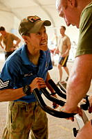 Sergeant Debbie Grylls, a Royal Australian Air Force Physical Training Instructor (PTI), trains International Security Assistance Force personnel at Multi National Base – Tarin Kot.