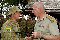 Chief of Defence Force, General David Hurley, AC, DSC presents Corporal Travis Draper from the Combined Task Force 635 (CTF 635) with a Commander's Commendation.