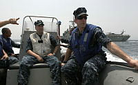 US Navy crew of Mine Counter Measure Ship USS Devastator, onboard a Rigid Hulled Inflatable Boat.