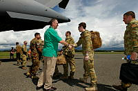 Australian High Commissioner to Solomon Islands, Matthew Anderson (centre) and the Commanders of Combined Task Force 635 (CTF 635), farewell members as they board the No. 36 Squadron C-17 Globemaster.