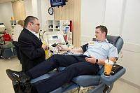 2013 Defence Force Blood Ambassador Joe Guarnieri chats with Officer Cadet Geordie Jacobs as Geordie makes his first donation for the 2013 Defence Force Blood Challenge.