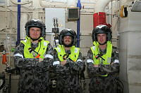 HMAS Newcastle's Lieutenant Gareth Giles, Leading Seaman Marine Technician Ethan Boland and Able Seaman Adam O'Brien ready for a helicopter transfer to Royal Fleet Auxiliary Fort Victoria to experience life on a British ship.