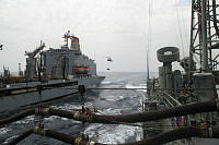 Fuel and Food, a replenishment at sea with USNS Patuxent. HMAS Newcastle's embarked S70B-2 Helicopter, Gremlin, transfers stores while HMAS Newcastle refuels.