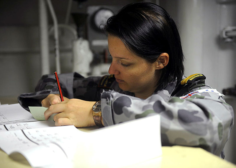 Lieutenant Alisha Withers prepares a postal vote while HMAS Newcastle is berthed at Aqaba, Jordon during the 2013 elections.