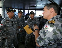 Commanding Officer of Ardent Three, Lieutenant Commander Michael Miller briefs officers from the Tentara Nasional Indonesia Angkatan Laut (TNI-AL) during CORPAT operations.
