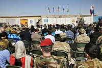 Guests from a host of nations listen during the Recognition Ceremony at Multi National Base - Tarin Kot on October 28 to formally acknowledge the contribution of Australia and its coalition partners in Uruzgan.