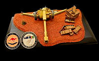 The model of a D-30 howitzer presented to Captain Abdul Sakad, Battery Commander 4th Brigade 205th Hero Corps, by Sergeant Troy Charters, 8th/12th Regiment Royal Australian Artillery.