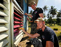 Sub Lieutenant Steven McGregor and Able Seaman Medical Underwater Lachlan Cox paint Yandina Community School in Russell Islands during a community engagement day as part of Operation RENDER SAFE 2013, Solomon Islands.