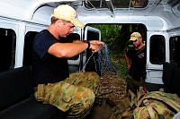 Corporal Christopher Charlton and Petty Officer Rob McDonald from 20th Explosives Ordnance Squadron, 6th Engineer Regiment, prepare equipment to render safe a projectile at Hells Point, Honiara during Operation RENDER SAFE.