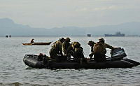 Royal Australian Navy Clearance Diving Team Four depart a beach in Ormoc, Philippines, after conducting beach reconnaissance for the Recovery Support Force amphibious landing during Operation PHILIPPINES ASSIST.
