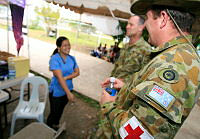 No. 2 Expeditionary Health Squadron Nursing officer Flight Lieutenant Paul Green (right) and Medic Flight Sergeant Les Plapp get to know local medical staff in the waiting area for displaced persons at Cebu airport.