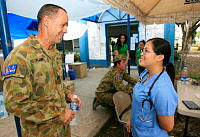 No. 2 Expeditionary Health Squadron's Medic Flight Sergeant Les Plapp talks with local Doctor Janice Bellezas from the Department of Health in the waiting area for displaced persons at Cebu airport.
