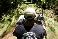 Petty Officer Second Class EOD 2 Chris Liberto transports cement on a US Navy quad bike to help renovate Nukufero Primary School on Russell Islands during Operation RENDER SAFE.