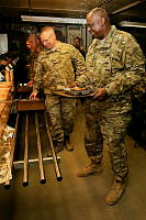 (L-R) Major General Paul J. LaCamera, Commander Regional Command (South) and General Lloyd J. Austin III, Commander US Central Command, join coalition troops for Thanksgiving dinner and the final meal prepared at Multi National Base Tarin Kot on November 28.
