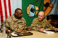General Lloyd J. Austin III, Commander US Central Command, and Colonel Wade Stothart, Commander Combined Team Uruzgan, join coalition troops for Thanksgiving dinner and the final meal prepared at Multi National Base Tarin Kot on November 28.