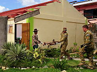 Local Filipinos and Australian Defence Force personnel help with the clean up of Liloan National High School, Ormoc, Philippines during Operation PHILIPPINES ASSIST.