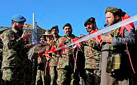 Prayers prior to the cutting of the ribbon to mark the opening the new army barracks in Tarin Kot.