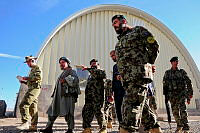 Australian Colonel Wade Stothart (left) inspects the new Army barracks at Tarin Kot with local Afghan commanders.