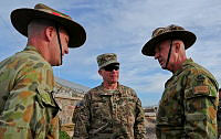 (L-R) Commander Combined Team Uruzgan Colonel Wade Stothart, Commander Regional Command (South) Major General Paul LaCamera, and Commander Joint Task Force 633 Major General Craig Orme, discuss security gains in Uruzgan province.