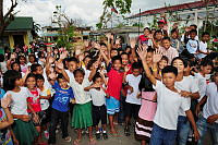 Students from Ipil Central School in Ormoc City wave to the camera during Operation PHILIPPINES ASSIST.