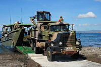 A dump truck and excavator from 3rd Combat Engineer Regiment are loaded for return to Australia on HMAS Tobruk after completing recovery tasks in the Philippines.