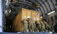 Royal Australian Air Force troops load a C-17A Globemaster aircraft with equipment on 13 December 2013.