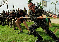 Philippines Army Sergeant Tolop plays tug of war with Australian troops at the 19th Infantry Commando Battalion in Kananga during Operation PHILIPPINES ASSIST.