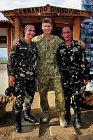 Philippines Army Colonel Dinoh Dolina, Commander 802nd Infantry Brigade (left), Australian Army Lieutenant Colonel Rod Lang, Commander Joint Task Force 630 and Philippines Army Lieutenant Colonel Nedy Espulgar, Commander 19th Infantry Commando Battalion, pose for a photo outside the newly erected diningg facility at the 19th Infantry Commando Battalion in Kananga during Operation PHILIPPINES ASSIST.