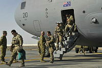Major General Craig Orme, Commander Joint Task Force 633, greets the last Australian Defence Force personnel to leave Tarin Kot, as they disembark from a Royal Australian Air Force C-17A Globemaster at Minhad Air Base.
