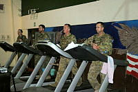 Deployed Navy, Air Force and Army personnel from Operation MAZURKA (from left) Captain Angela Madden, Petty Officer Les Trapp, Warrant Officer Class 2 Glenn Brown and Warrant Officer Class 2 Mick Chattin, march on their treadmills for a fundraising walk in the Sinai, Egypt.