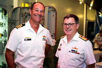 Commanding Officer HMAS MELBOURNE, Commander Brian Schlegel (left), greets Commander Combined Task Force 150, Commodore Daryl Bates, Royal Australian Navy (right), on board HMAS MELBOURNE