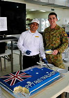 Craftsman (CFN) Craig Beard enjoys a slice of a specially made Australia Day cake at the All Ranks Mess, Al Mihad Air Base in the United Arab Emirates.