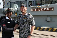 Greenies united, Petty Officer Tapan from the Bangladesh Navy and Leading Seaman Joshua Hobbs meet at the official welcoming ceremony as HMAS Childers comes alongside Chittagong in Bangladesh.