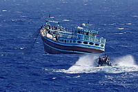HMAS Melbourne's boarding party proceeding to intercept a suspicious dhow in the Middle East Area of Operations.