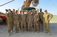 Members of Force Communications Unit-10 (FCU-10) theatre line detachment working in co-operation with 62nd Expeditionery Signal Battalion (ESB) around Kandahar Air Field uninstalling aerial cabling.