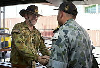 (R-L) Commanding Officer HMAS Darwin Commander Terence Morrison, RAN, greets Deputy Commander Joint Task Force 633, Commodore Philip Spedding, DSC, AM, RAN during a visit to the ship for INCHOP briefings, whilst alongside in Muscat, Oman.