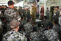 Commander Joint Task Force 633, Major General Craig Orme, AM, CSC, briefs HMAS Darwin ship's company on their Operation Slipper deployment, during a port visit to Muscat, Oman.