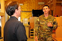UNAMA's Chief of Mission Support, Vincent Smith (left), talks to Captain Lachlan McCallum during his visit to Camp Baker.