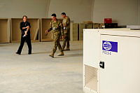 UNAMA's Chief of Mission Support, Vincent Smith (left), looks over potential acquisitions in the form of office furniture and generators at the Australian Logistics Annex.