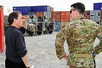UNAMA's Chief of Mission Support, Vincent Smith (left), talks to Captain Lachlan McCallum during his visit to the Australian Logistics Annex, where other surplus materials are being stored.