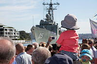 Family and friends of the crew of HMAS Melbourne cheer as the ship returns home alongside Garden Island, Sydney, after a six-month deployment to the Middle East Area of Operations (MEAO).