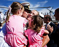 Commanding Officer HMAS Melbourne, CMDR Brian Schlegel, RAN, gives his wife a long awaited kiss after a six-month deployment to the Middle East Area of Operations (MEAO).