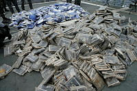 Individual packets of illegal narcotics seized from a skiff operating in the Arabian Sea.