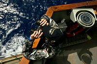 Able Seaman Boatswains Mate Marc Chandler holds lookout onboard HMAS SUCCESS whilst deployed in search of the missing Malaysia Airlines Flight MH370.